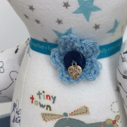 Extra embellishment of a baby grow bear